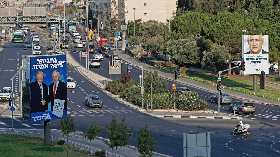 "This picture taken on September 16, 2019 shows Israeli election billboards in a street in Jerusalem (L to R) for the Likud party showing US President Donald Trump shaking hands with Likud chairman and Prime Minister Benjamin Netanyahu with a caption in Hebrew reading ""Netanyahu, in another league""; and another for the ""Blue and White"" (Kahol Lavan) electoral alliance showing the face of retired general Benny Gantz and a caption in Hebrew reading ""only with the Blue and White will create a united secular government"". (AFP)"