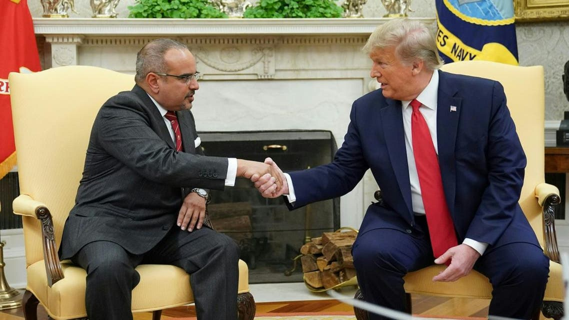 US President Donald Trump (R) shakes hands with Bahrain's Crown Prince Salman bin Hamad bin Isa al-Khalifa during a meeting in the Oval Office of the White House on September 16, 2019 in Washington, DC. (AFP)