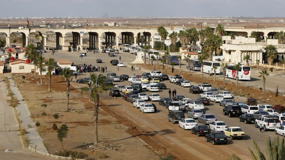 Vehicles wait to cross into Syria at the recently reopened Nassib border post in the Deraa province,at the Syrian-Jordanian border south of Damascus on November 7, 2018. Syrian regime forces retook control of the Nassib border crossing from rebels in July, and last month reopened it after a three-year closure, allowing Jordanians to dash over for cheap shopping.