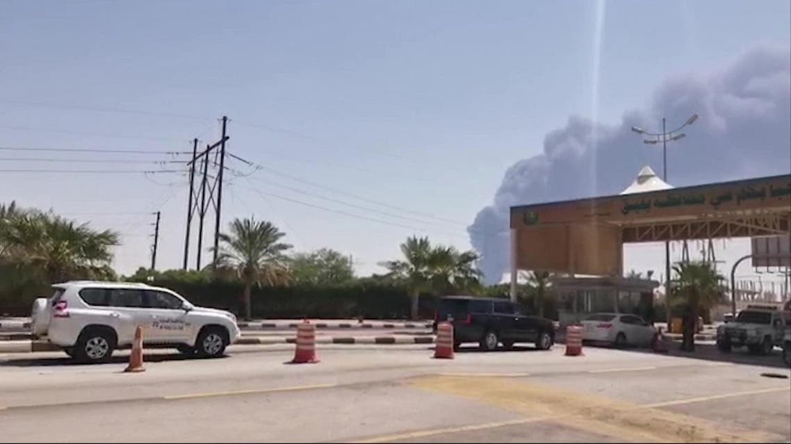 This AFPTV screen grab from a video made on September 14, 2019, shows smoke billowing from an Aramco oil facility in Abqaiq about 60km (37 miles) southwest of Dhahran in Saudi Arabia's eastern province. (AFP)