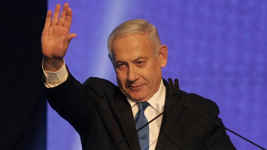 Israeli Prime Minister Benjamin Netanyahu waves as he addresses supporters at his Likud party's electoral campaign headquarters in the coastal city of Tel Aviv early on September 18, 2019. (AFP)