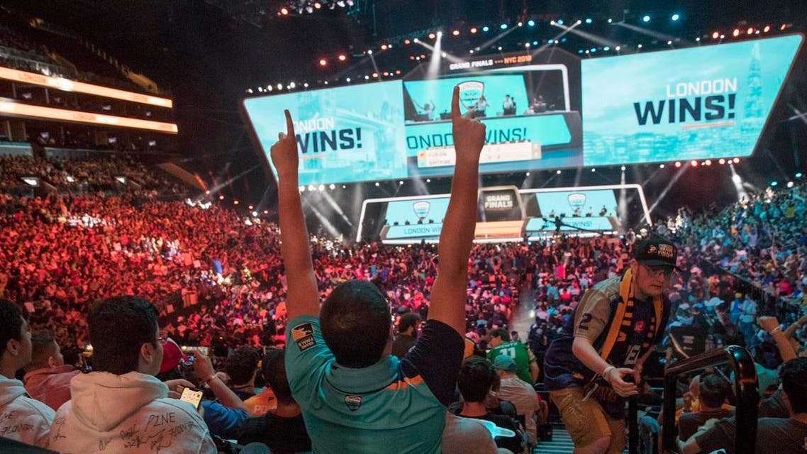 London Spitfire fan Rick Ybarra, of Plainfield, Ind., reacts after London won the second game against the Philadelphia Fusion. (File photo: AP)