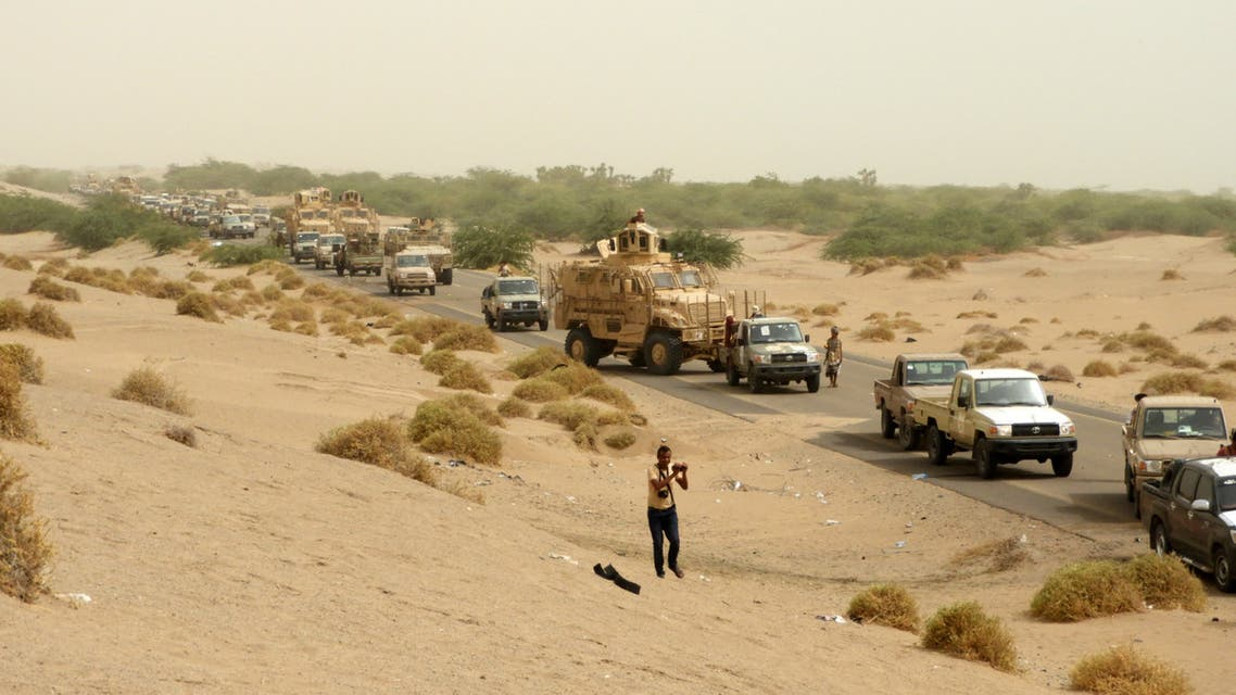 Yemeni pro-government forces arrive in al-Durayhimi district, about nine kilometres south of Hodeidah international airport on June 13, 2018. Yemeni forces backed by the Saudi-led coalition launched an offensive on June 13 to retake the rebel-held Red Sea port city of Hodeida, pressing toward the airport south of the city.