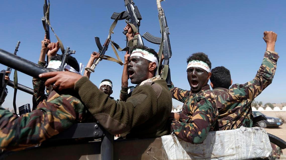 Newly recruited Houthi militants chant slogans as they ride a military vehicle during a gathering in the capital Sanaa. (File photo: AFP)