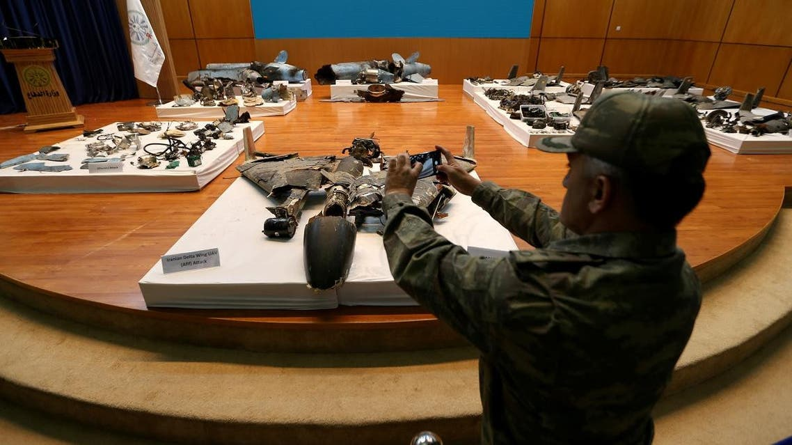 Security personnel takes pictures of remains of the missiles which used to attack an Aramco oil facility. (Reuters)