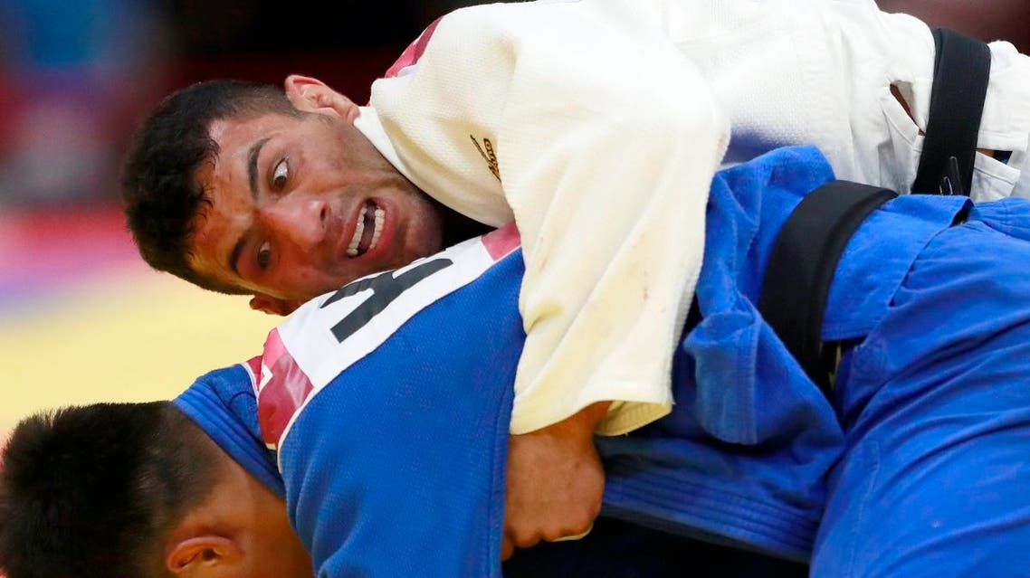 In this Thursday, Aug. 30, 2018 file photo, Saeid Mollaei of Iran, top, competes against Didar Khamza of Kazakhstan during their men's - 81kg final judo match at the18th Asian Games in Jakarta, Indonesia.(AP)