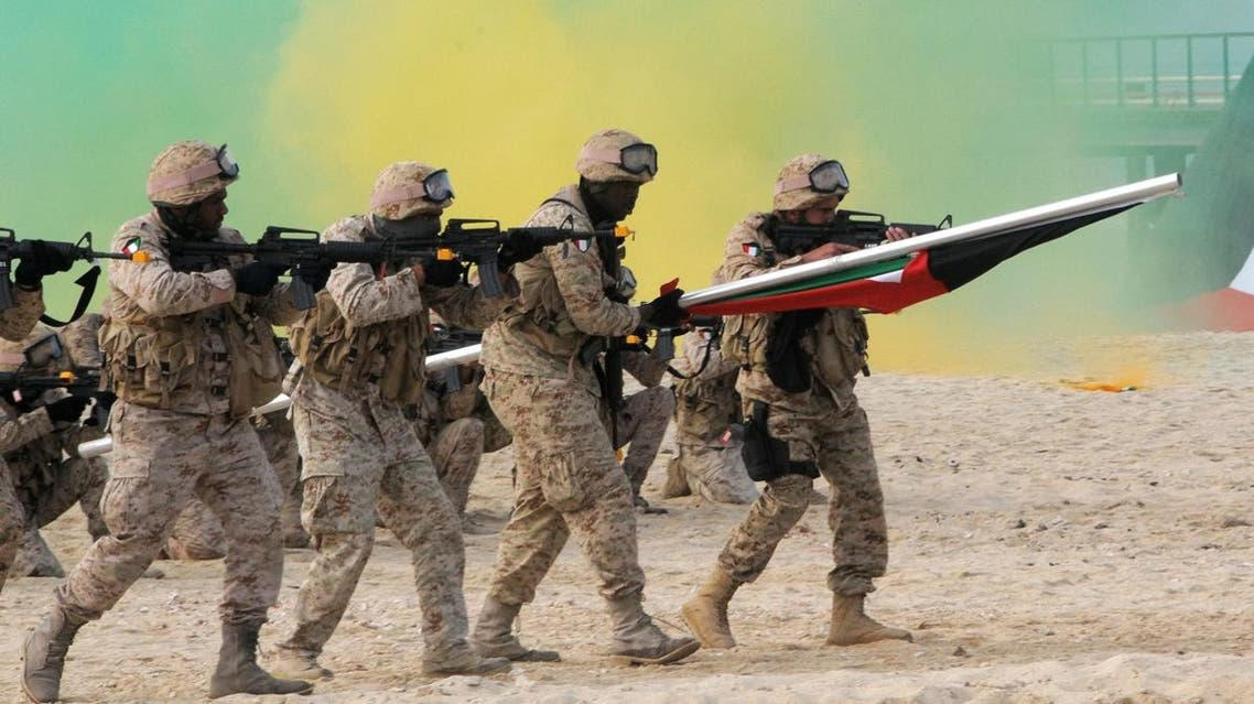 Kuwaiti marines re-enact the landing at Garouh Island, Kuwait, on Wednesday Jan. 25, 2011. (AP)