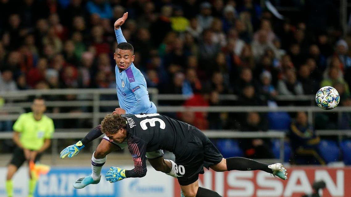 Manchester City's Gabriel Jesus collides with Shakhtar's goalkeeper Andriy Pyatov during the Group C Champions League soccer match in Kharkiv, Ukraine, Wednesday, Sept. 18, 2019. (AP)