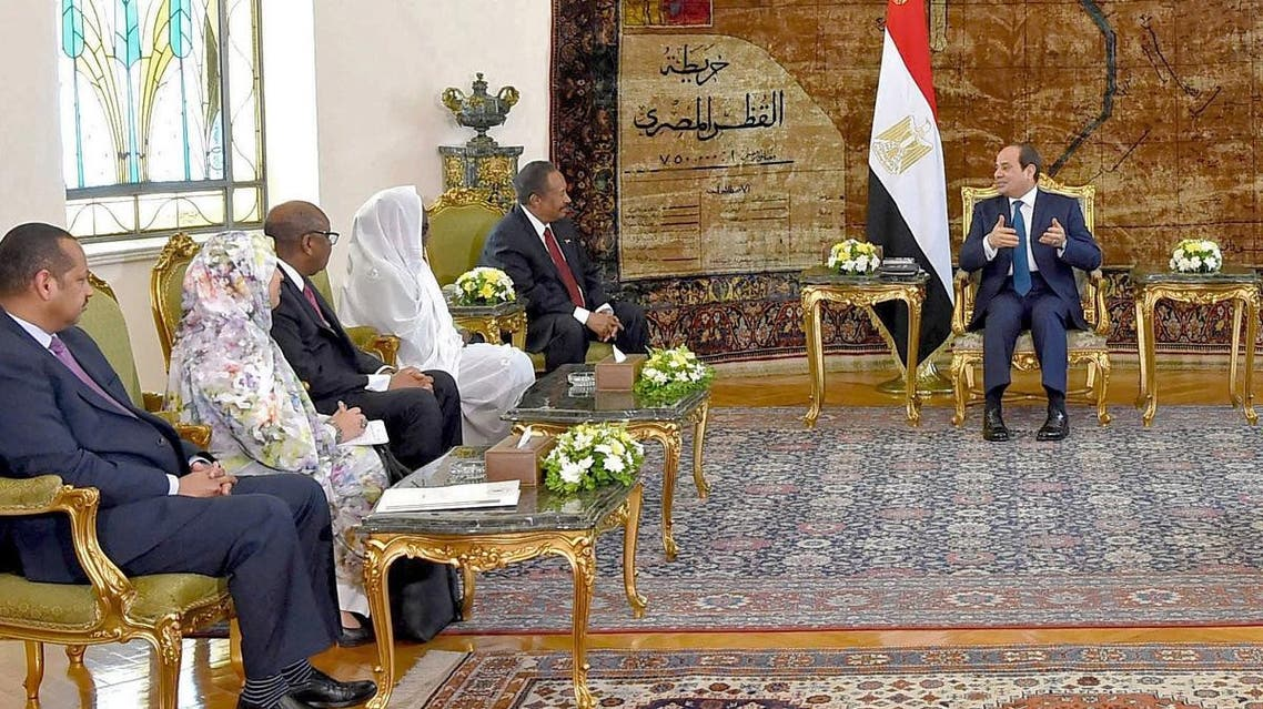 Egyptian President Abdel Fattah al-Sisi (R) meeting with Sudan's Prime Minister Abdalla Hamdok (2nd-R) at the Ittihadia presidential palace in the capital Cairo on September 18, 2019. (AFP)