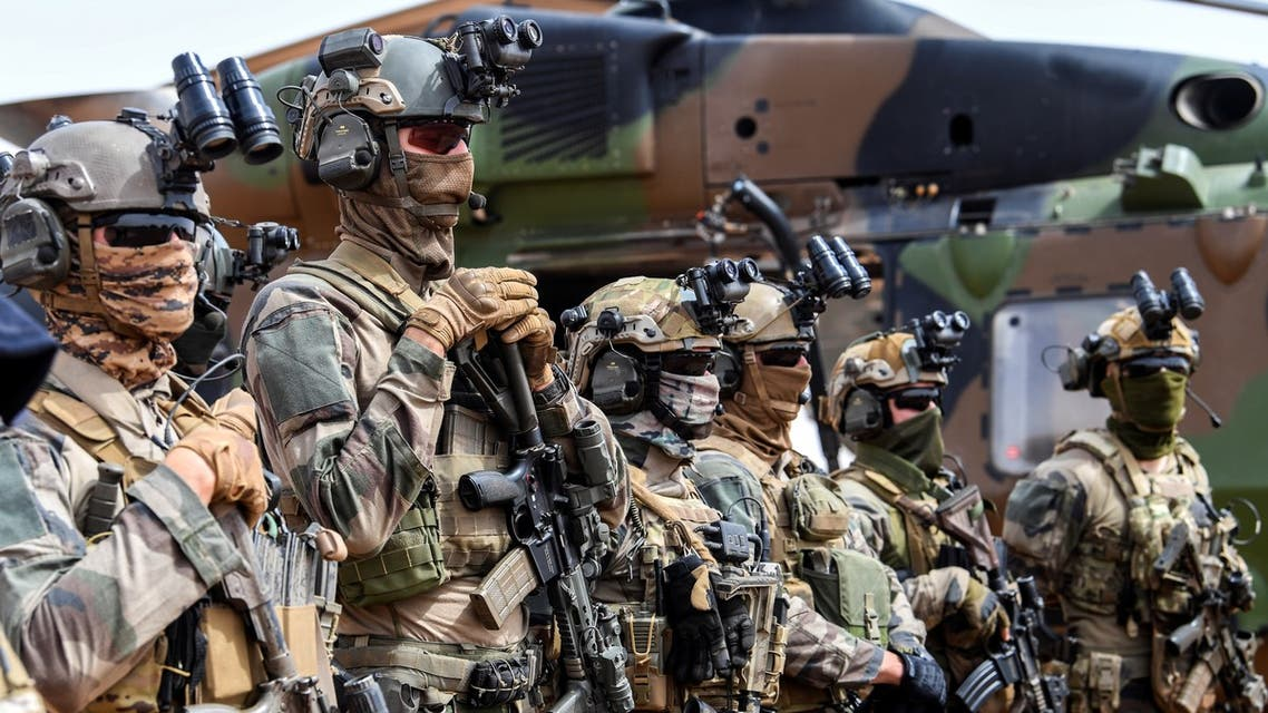French commandos stand in line during the French Prime Minister's visit at Operation Barkane at the French base in Gao, Mali on February 24, 2019.