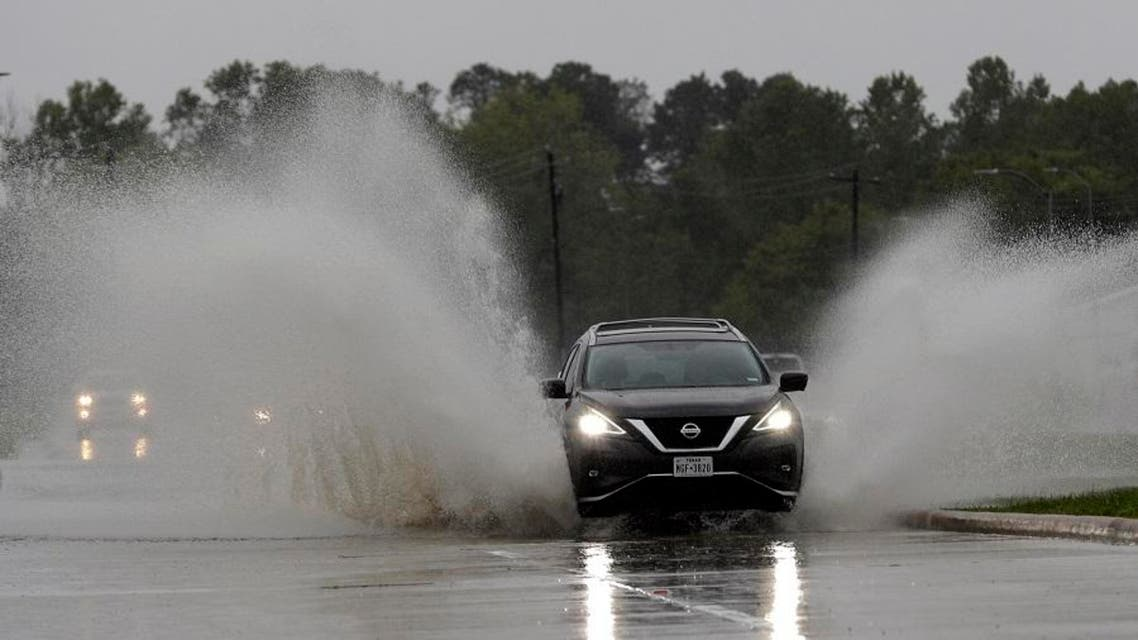A car drives through floodwaters from Tropical Depression Imelda on Septmber 18, 2019, in Houston. (AP)
