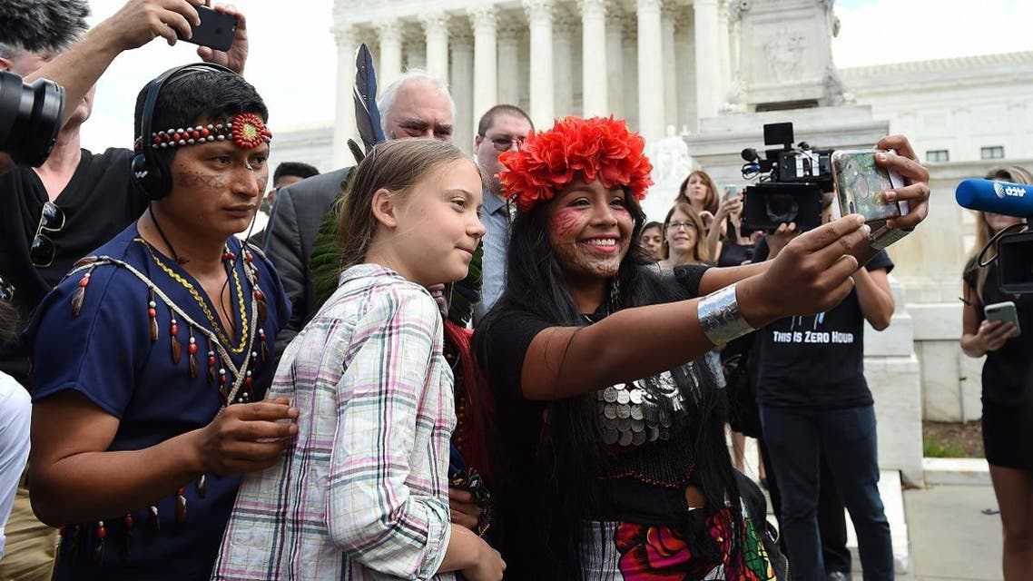 Militza Flaco (R) from the Global Alliance of Territorial Communities Guardians of the Forest takes a selfie with Swedish teen climate activist Greta Thunberg in front of the Supreme Court to support the children's climate lawsuit against the US on September 18, 2019 in Washington, DC. (AFP)