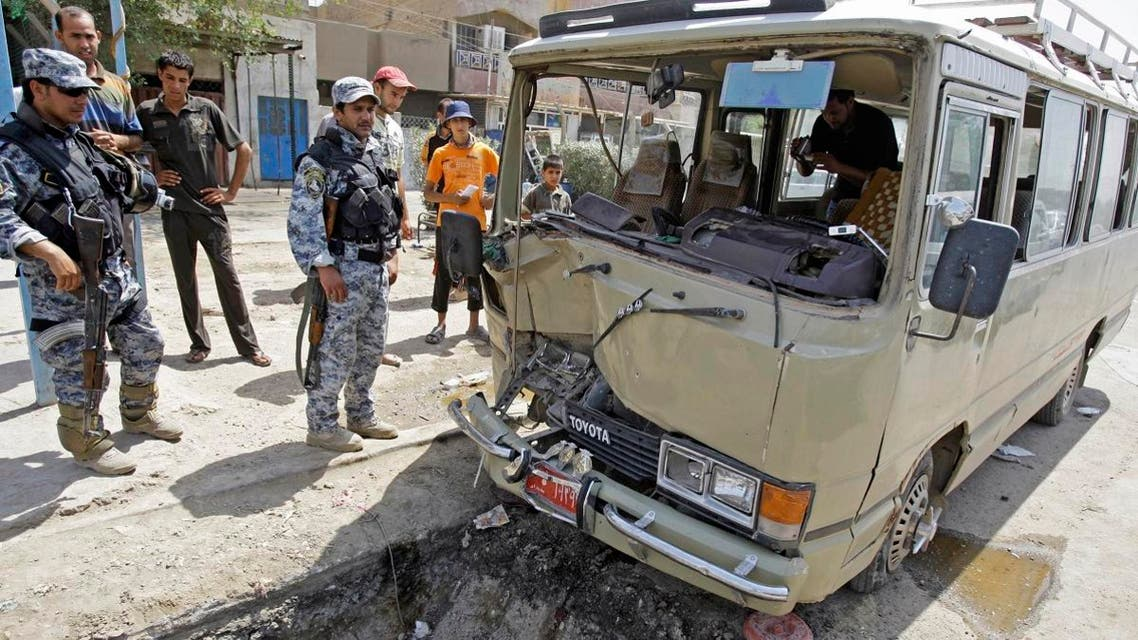 File photo of Iraqi policemen secure the scene of a road side bomb blast that hit a mini bus carrying Shiite pilgrims in Sadr City, in Baghdad, Iraq. (AP)