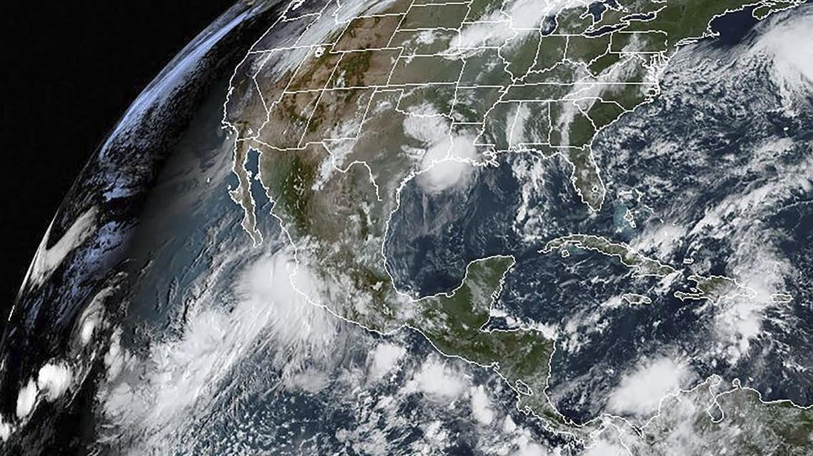 This satellite image obtained from NOAA/RAMMB, shows Hurricane Lorena(L) at 13:0 UTC on September 19, 2019 as it made landfall on the southwest coast of Mexico. (AFP)