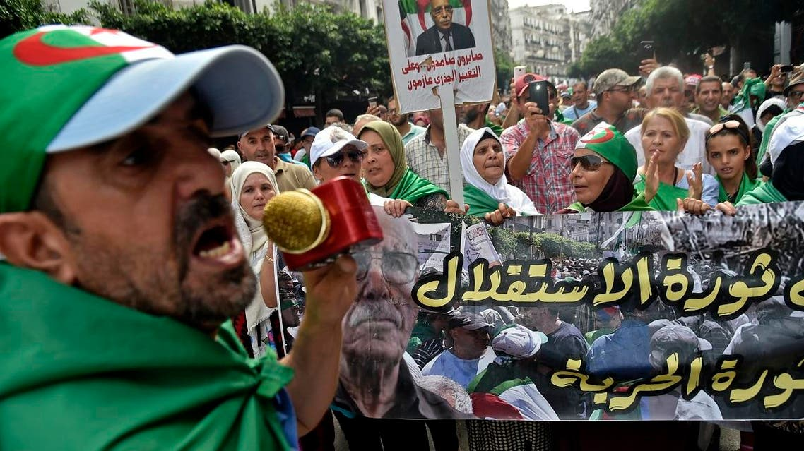 Algerian protesters take part in a demonstration against the country's army chief in Algeria's capital Algiers on September 20, 2019, as the police toughens its line ahead of December elections. (AFP)