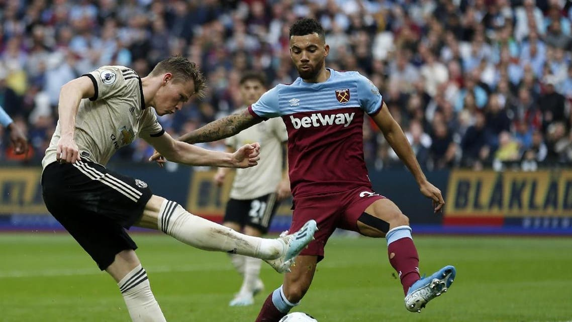 Manchester United's English midfielder Scott McTominay (L) vies with West Ham United's English defender Ryan Fredericks during the English Premier League football match between West Ham United and Manchester United at The London Stadium, in east London on September 22, 2019. (AFP)