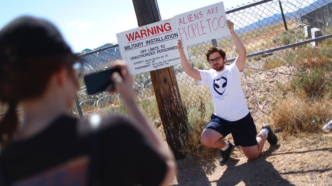 A man poses at an entrance gate to the Nevada Test and Training Range, located near Area 51, on September 20, 2019, near Rachel, Nevada. (AFP)