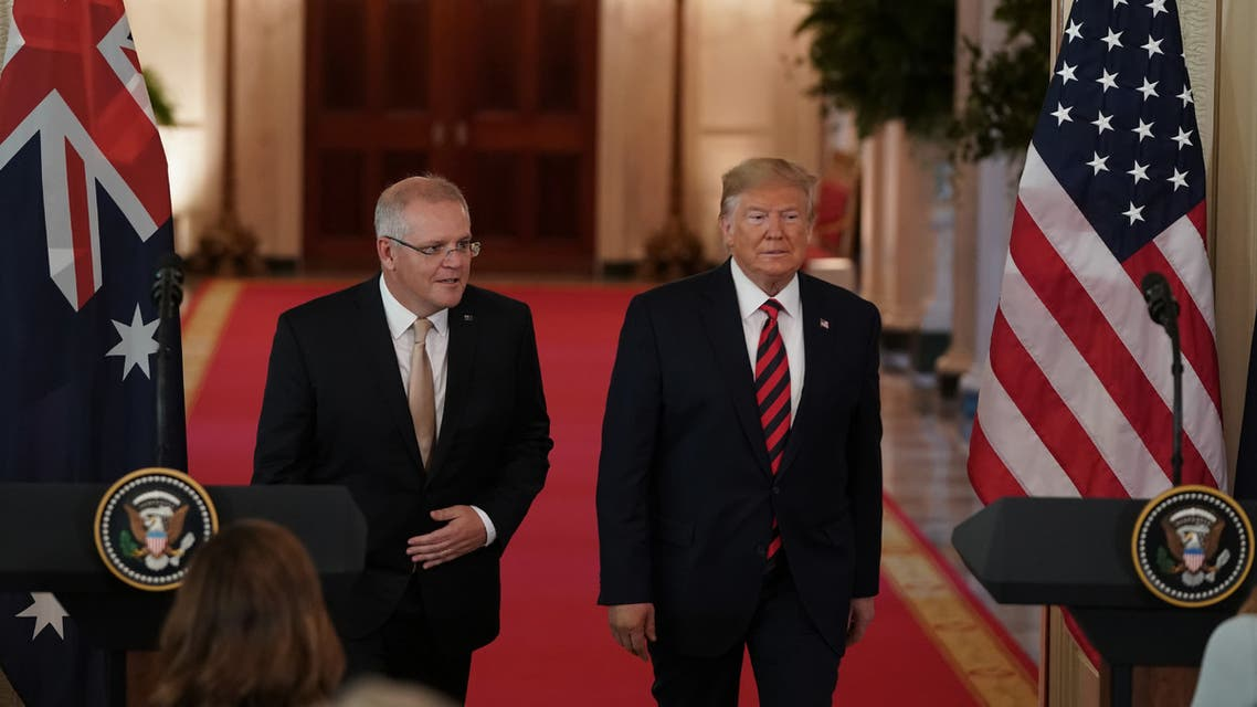 US President Donald Trump and Australian Prime Minister Scott Morrison arrive at a press conference in the East Room of the White House in Washington, DC, on September 20, 2019.