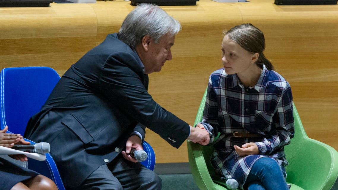 Swedish environmental activist Greta Thunberg (right), shakes hands with UN Secretary-General Antonio Guterres, during the Youth Climate Summit at United Nations headquarters, on September 21, 2019. (AP)