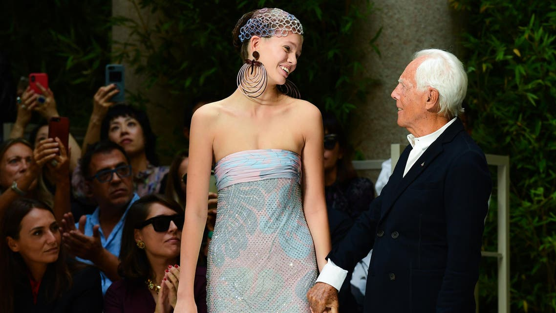 Italian fashion designer Giorgio Armani (R) acknowledges applause following the presentation of his Women's Spring Summer 2020 collection in Milan on September 21, 2019. (AFP)