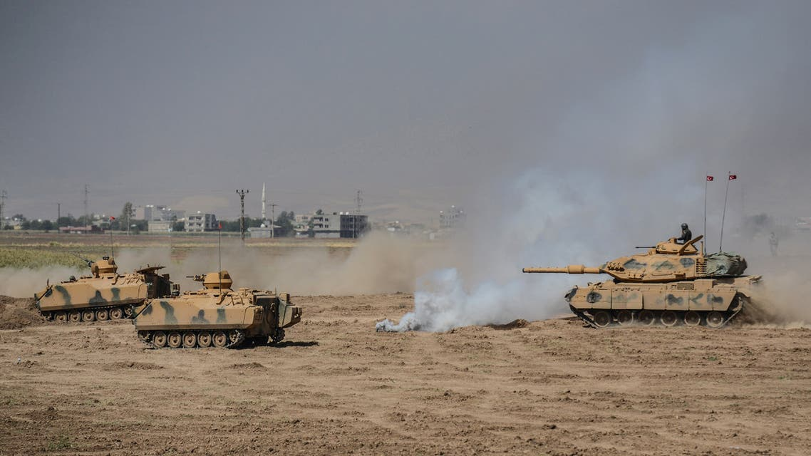 Turkish soldier ride armoured vehicles near the Habur crossing gate between Turkey and Iraq during a military drill on September 27, 2017 in the Silopi district, southeast Turkey. Iraqi soldiers on September 26 took part in a Turkish military drill close to the Iraqi border on Tuesday, an AFP photographer said, a day after Iraq's Kurdish region held a vote on independence.