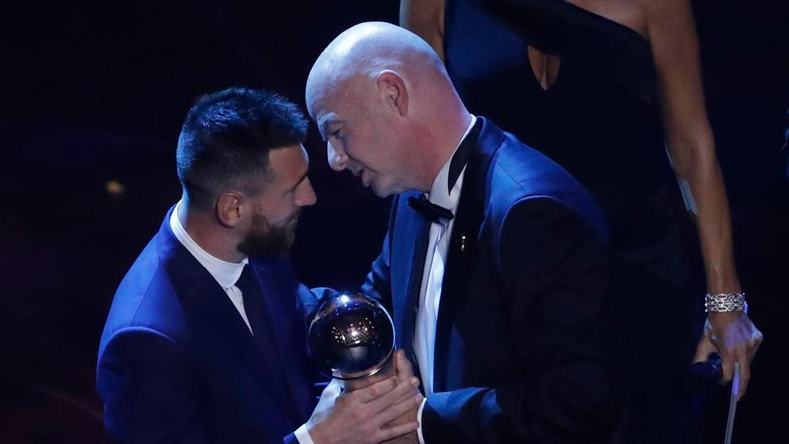Argentinian Barcelona player Lionel Messi receives the Best FIFA mens player award from FIFA president Gianni Infantino during the ceremony of the Best FIFA Football Awards, in Milan's La Scala theater, northern Italy, Monday, Sept. 23, 2019. (AP)