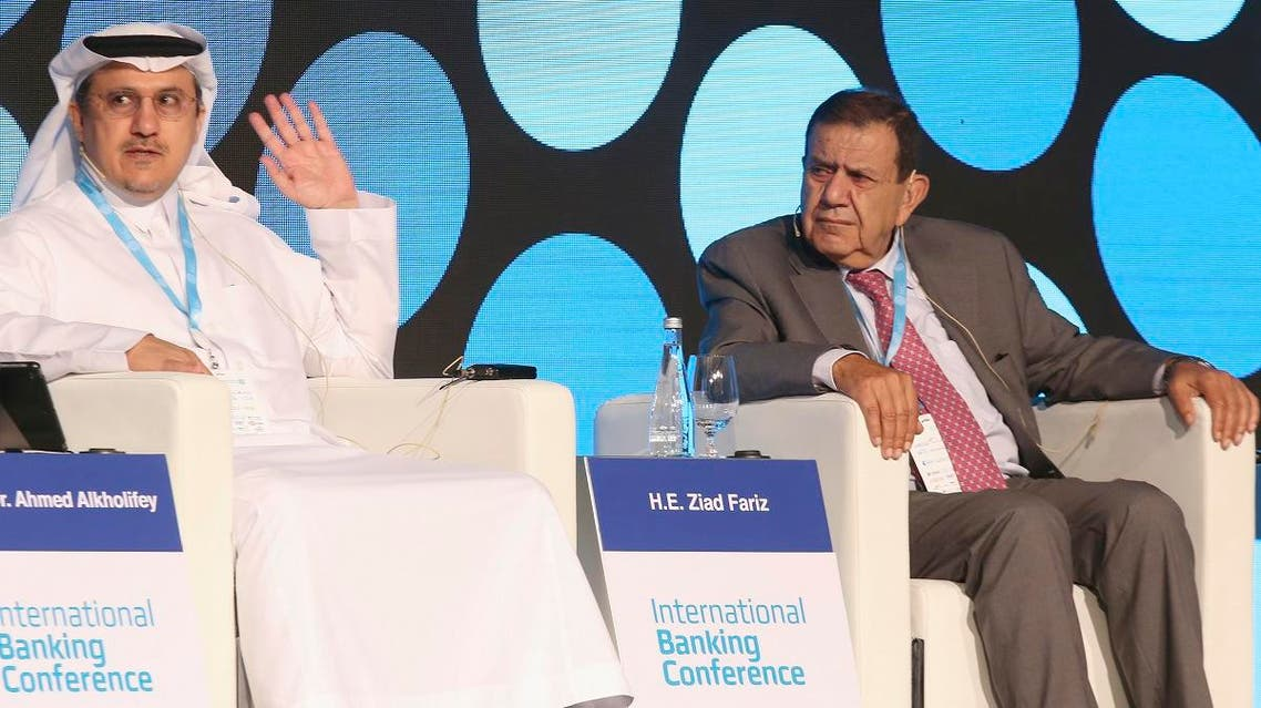 Ahmed al-Kholifey (L), chairman of the Saudi Arabian Monetary Authority, speaks in the presence of Ziad Fariz, Governor of the Central Bank of Jordan, during an international banking conference in Kuwait City on September 23, 2019. (AFP)