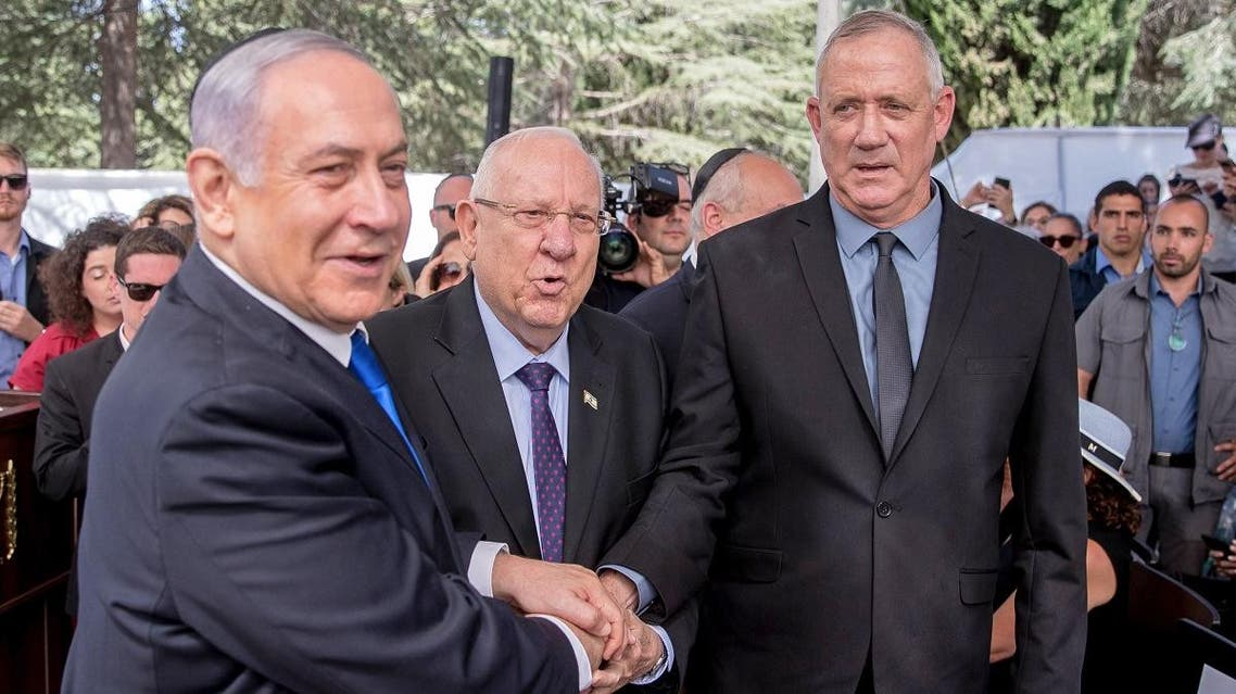 Israeli Prime Minister Benjamin Netanyahu (L), President Reuven Rivlin (C) and Benny Gantz, leader of Blue and White party, attend a memorial ceremony for late Israeli president Shimon Peres, at Mount Herzl in Jerusalem on September 19, 2019. (AFP)