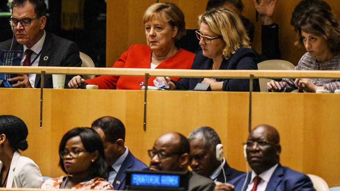 German Chancellor Angela Merkel listens to US President Donald Trump speak at the United Nations General Assembly on September 24, 2019 in New York City. (AFP)
