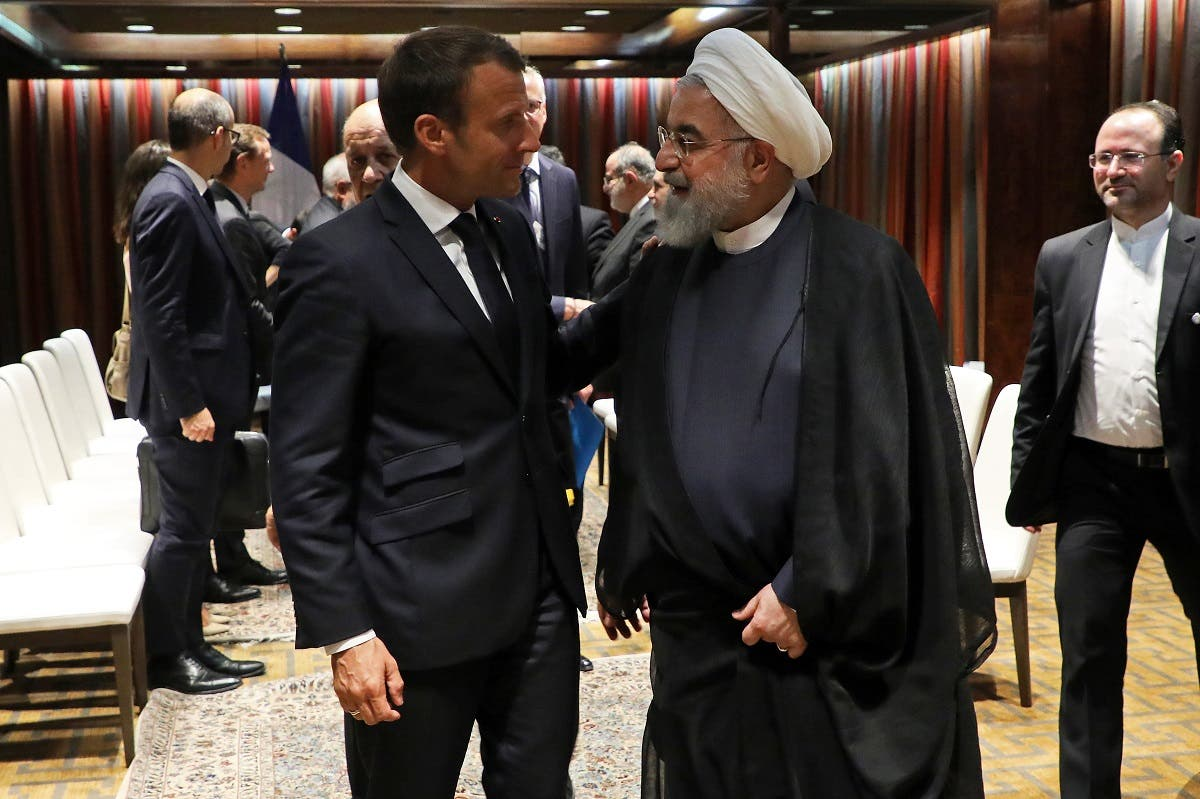French President Emmanuel Macron (L) and Iranian President Hassan Rouhani shake hands after a meeting at the United Nations headquarters on September 23, 2019, in New York. (AFP)