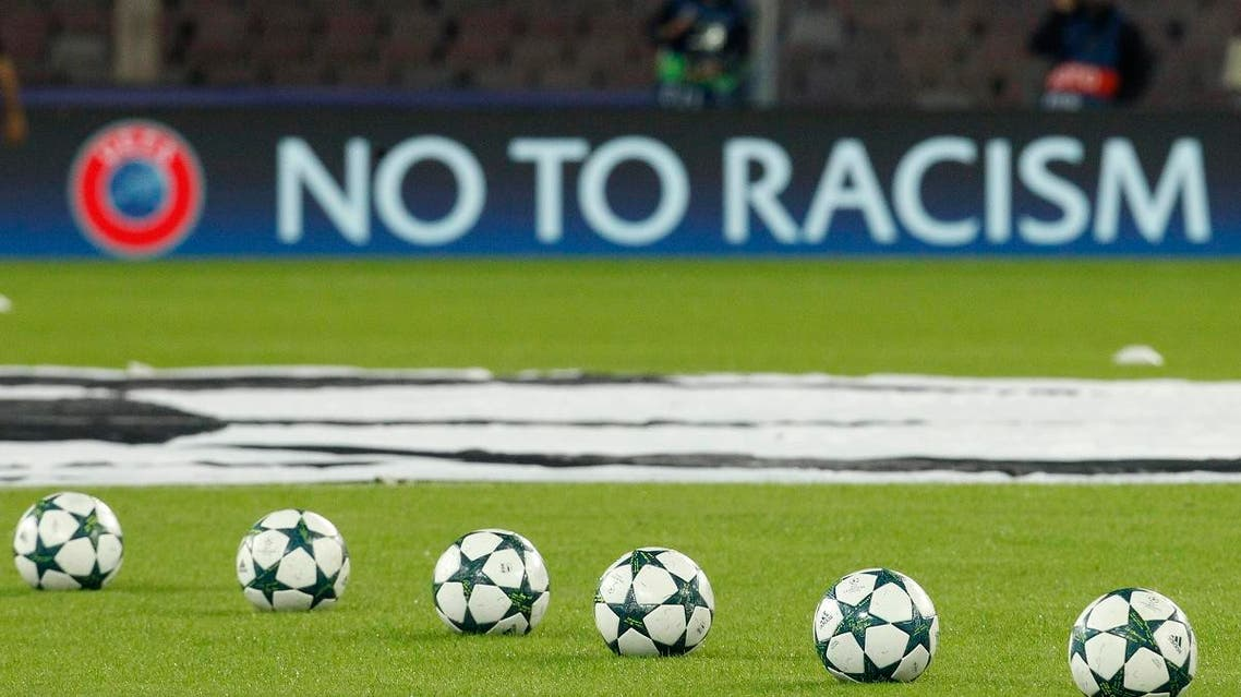 """The anti-racism slogan """"No to Racism"""" is displayed on a board along the pitch prior the UEFA Champions League football match. (File photo: AFP)"""