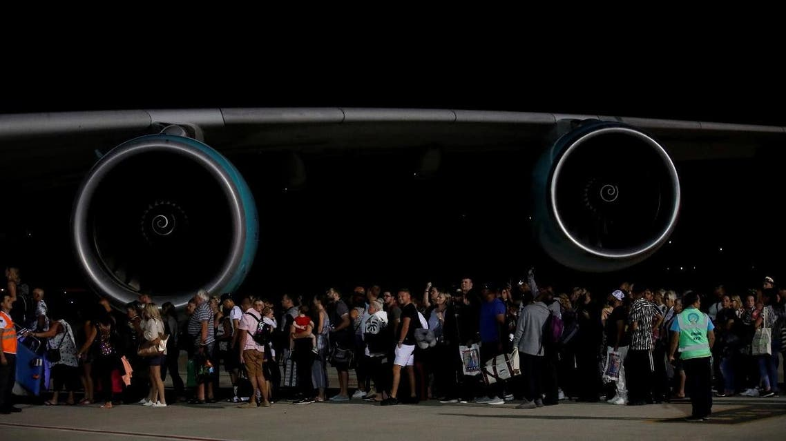 British passengers board an Airbus A380 airliner that is being used for transporting Thomas Cook customers at Dalaman Airport. (Reuters)