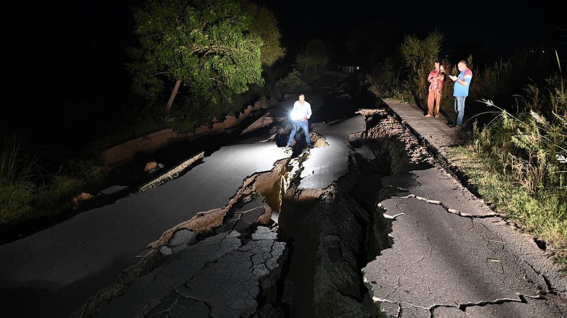 A news cameraman films a damaged road following an earthquake on the outskirts of Mirpur on September 24, 2019. (AFP)