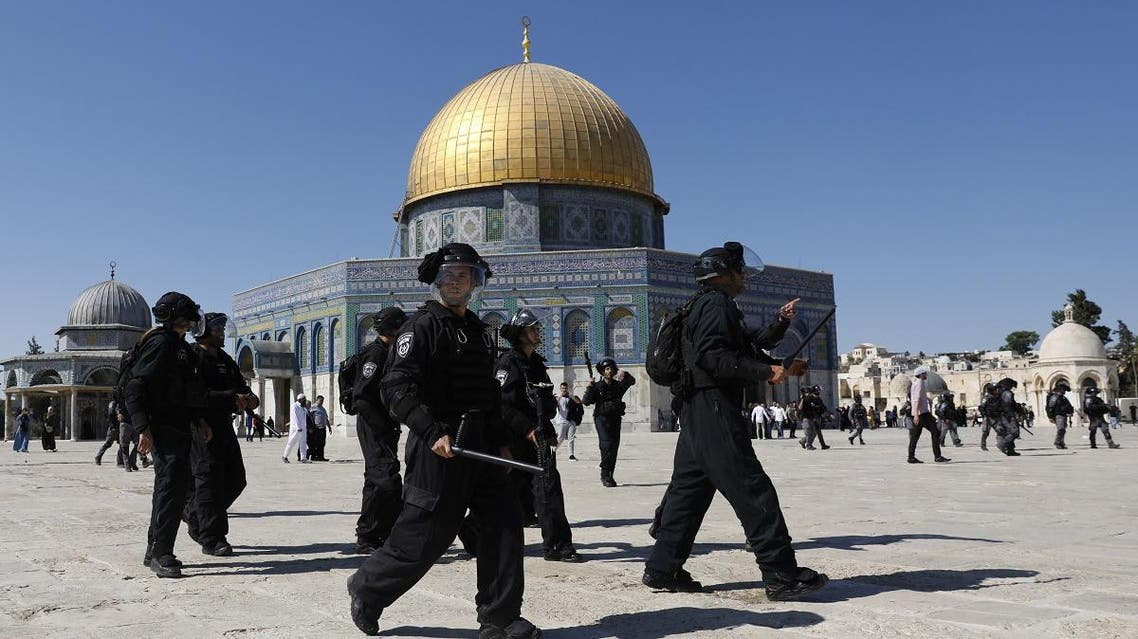 Israeli security forces walk past the Dome of the Rock mosque as they arrive at the Al-Aqsa mosques compound in the Old City of Jerusalem on August 11, 2019. (AFP)