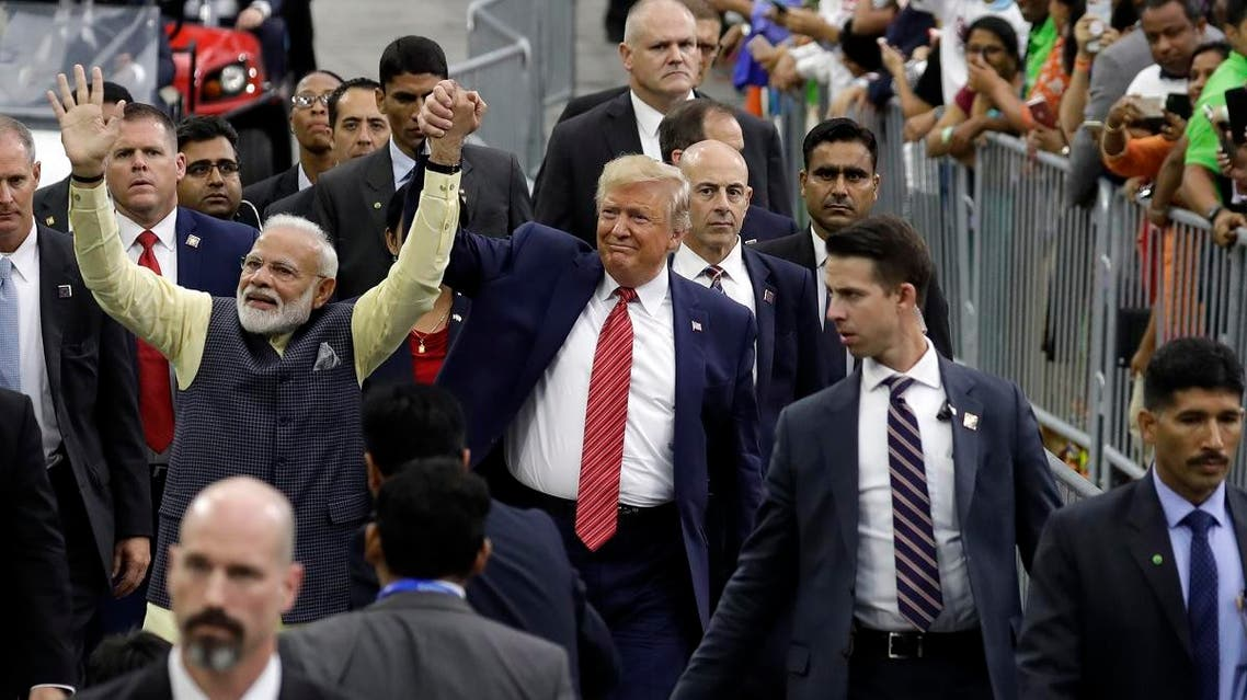 """President Donald Trump and Indian Prime Minister Narendra Modi walk around NRG Stadium waving to the crowd during the """"Howdy Modi: Shared Dreams, Bright Futures"""" event, on September 22, 2019, in Houston. (AP)"""