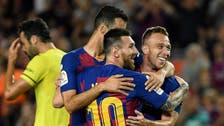 Barca secure win over Villarreal as Messi limps off