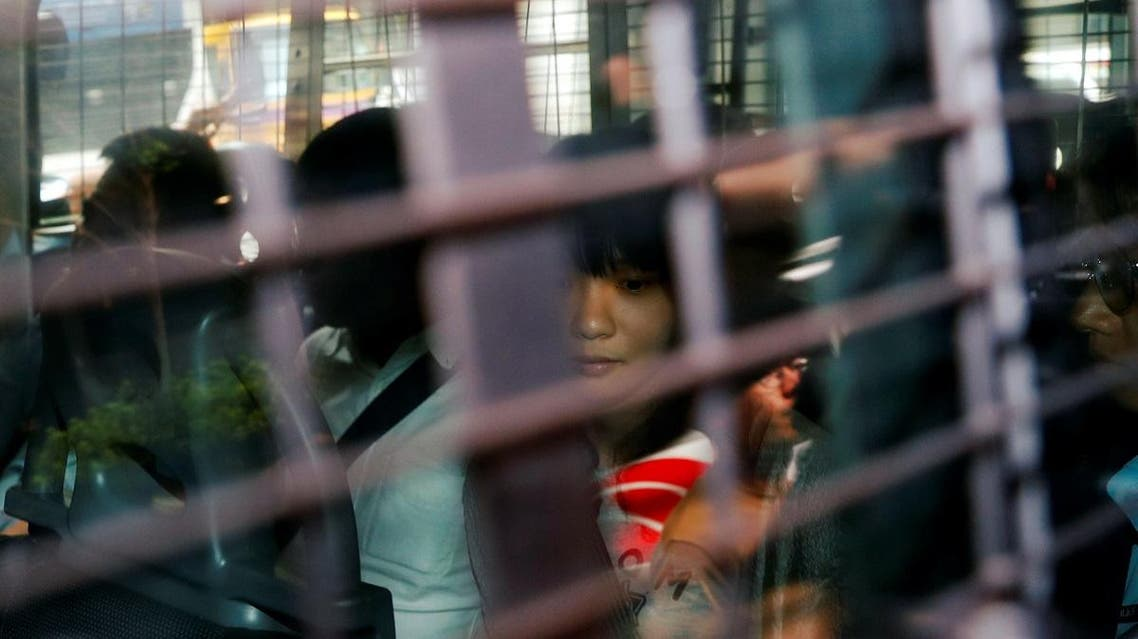 Agnes Chow, a member of the Demosisto, a pro democracy party in Hong Kong, is seen in a police van as she is brought to the Eastern Court after her arrest, in Hong Kong. (Reuters)