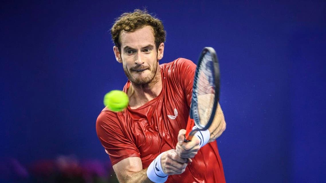 Andy Murray of Britain hits a return against Alex de Minaur of Australia during their men's singles second round match at the Zhuhai Championships tennis tournament in Zhuhai in China's southern Guangdong province on September 26, 2019. STR / AFP