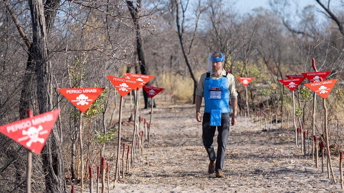 Britain's Prince Harry walks through a minefield in Dirico, Angola, Friday Sept. 27, 2019, during a visit to see the work of landmine clearance charity the Halo Trust, on day five of the royal tour of Africa. (AP)