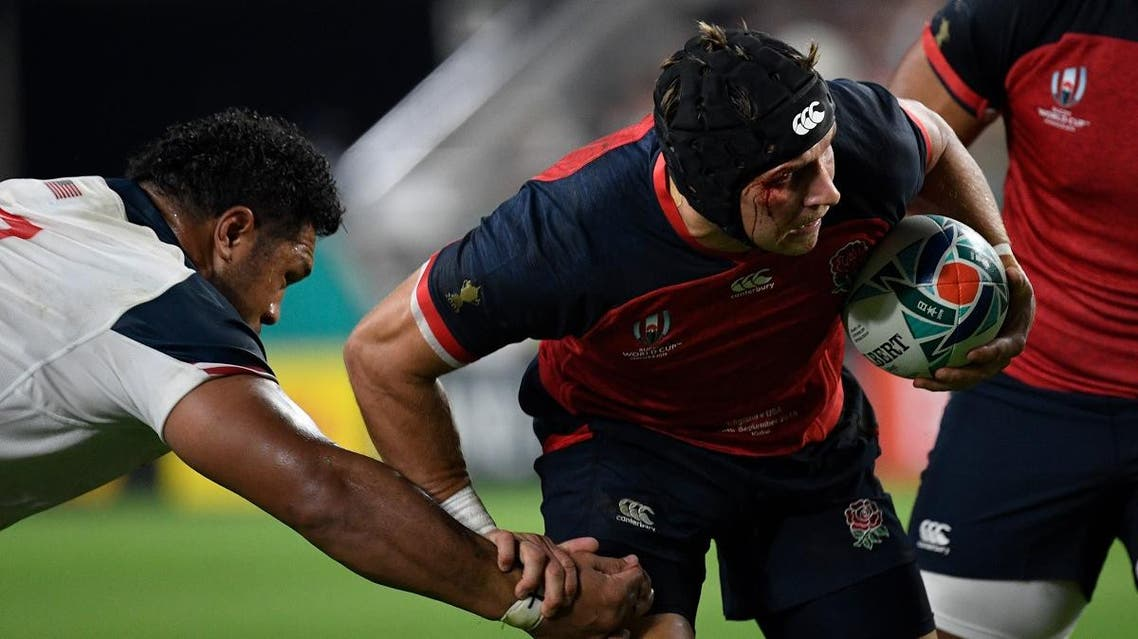 Piers Francis (R) runs with the ball during the Japan 2019 Rugby World Cup Pool C match between England and the United States. (AFP)