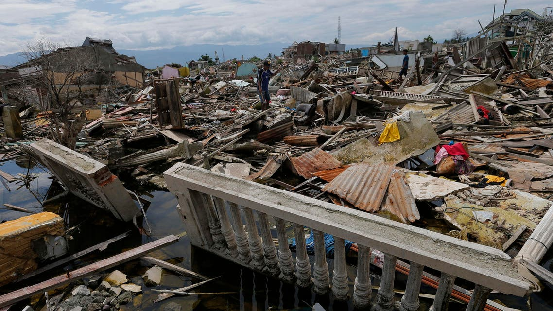 In this April 2, 2019, photo, a man walks through the destruction of Balaroa neighborhood wiped out by earthquake-triggered liquefaction in Palu, Central Sulawesi, Indonesia. (AP)