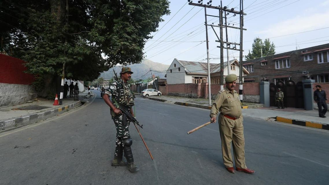 Policemen stand guard outside the residence of former chief minister of the Jammu and Kashmir state Farooq Abdullah in Srinagar. (Reuters)
