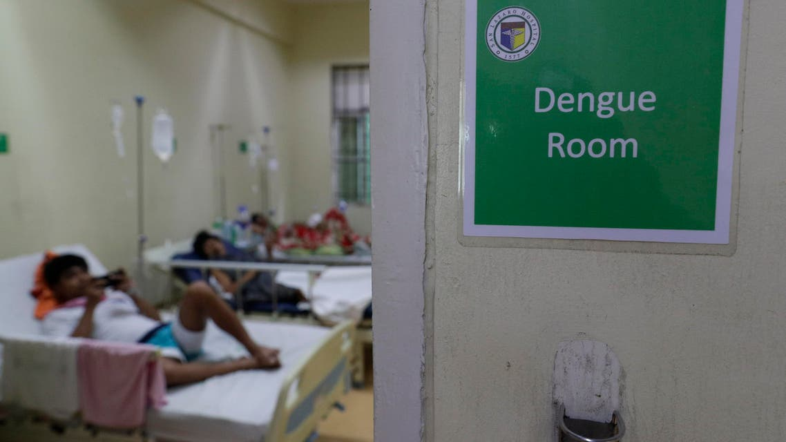 Filipino patients stay inside the dengue room at the San Lazaro government hospital in Manila, Philippines on Wednesday, Aug. 7, 2019. (AP)