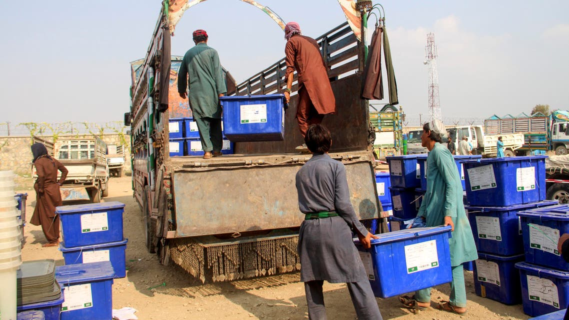 Employees of the Independent Election Commission (IEC) load ballot boxes on trucks in Khost province on September 26, 2019. (AFP)