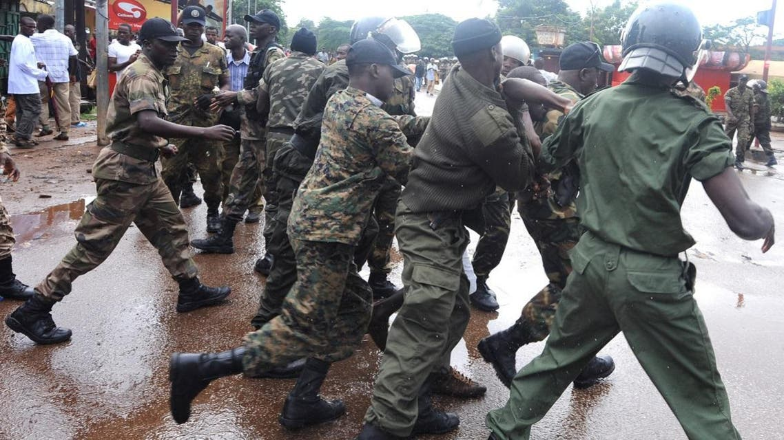 Guinean police arrest a protester on September 28, 2009, in front of the biggest stadium in the capital Conakry during a protest banned by Guinea's ruling junta at the time. (AFP)