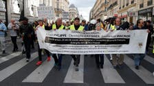 French police break up yellow vest protest with tear gas