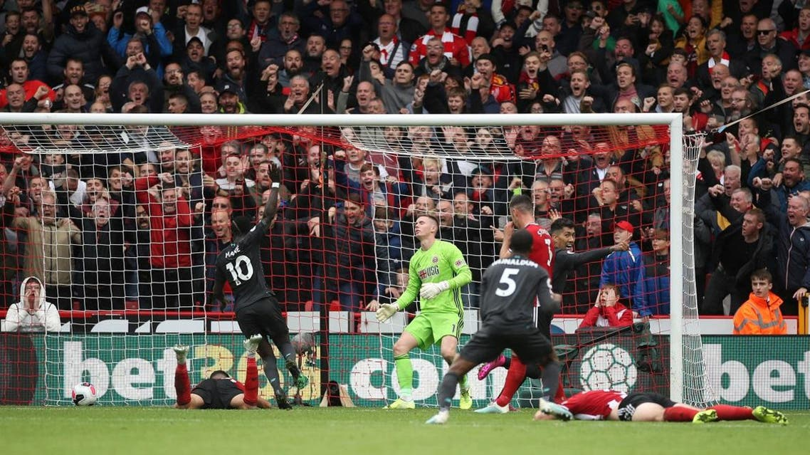 Liverpool's Georginio Wijnaldum celebrates scoring their first goal with Roberto Firmino and Sadio Mane as Sheffield United's Dean Henderson and team mates look dejected. (Reuters)
