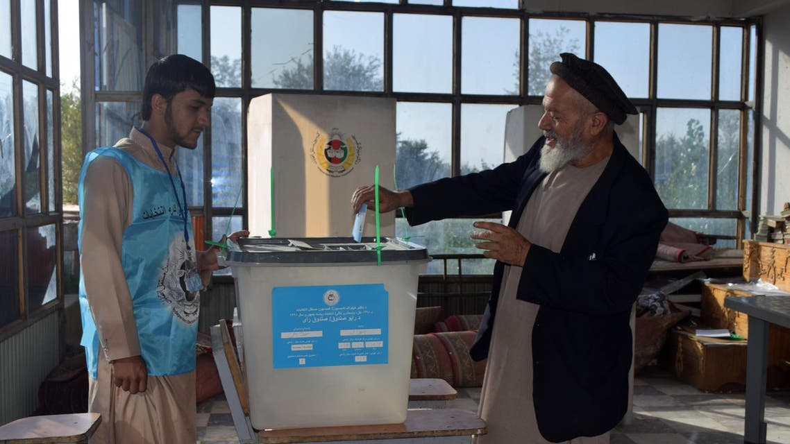 An Afghan man casts his ballot at a polling station in Parwan provence on September 28, 2019. (AFP)