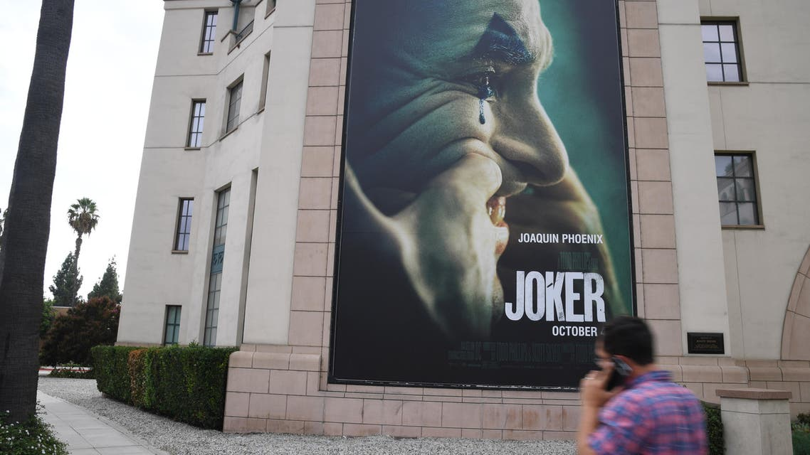 """A poster for the upcoming film """"The Joker"""" is seen outside Warner Brothers Studios in Burbank, California, September 27, 2019. (AFP)"""