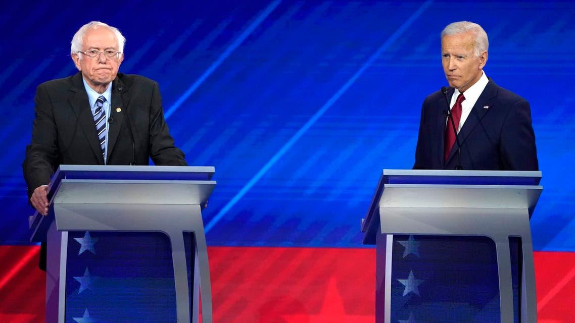 Senator Bernie Sanders and former Vice President Joe Biden stand beside each other in the final minutes of the 2020 Democratic U.S. presidential debate in Houston, Texas, U.S., September 12, 2019. REUTERS/Mike Blake